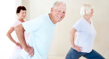 Elderly people making doing sports